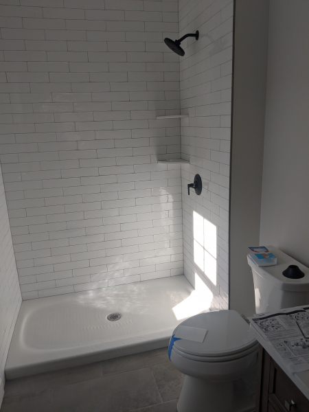 Finished bathroom with shower