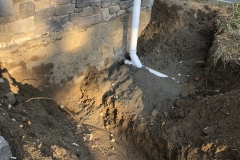 white sewer line installed for new house